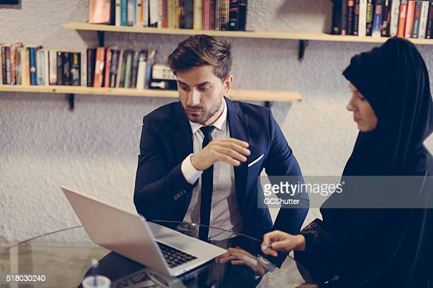 Businessman explaining project plans to colleague.