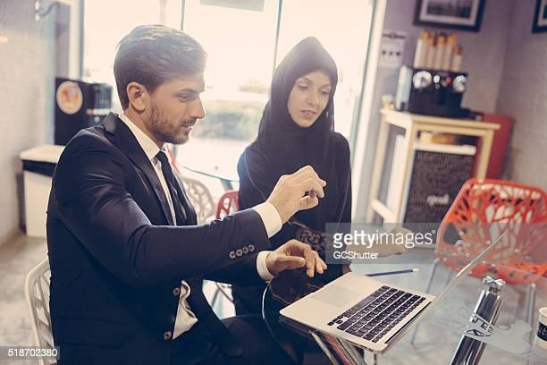 Businessman explaining project plans to colleague.