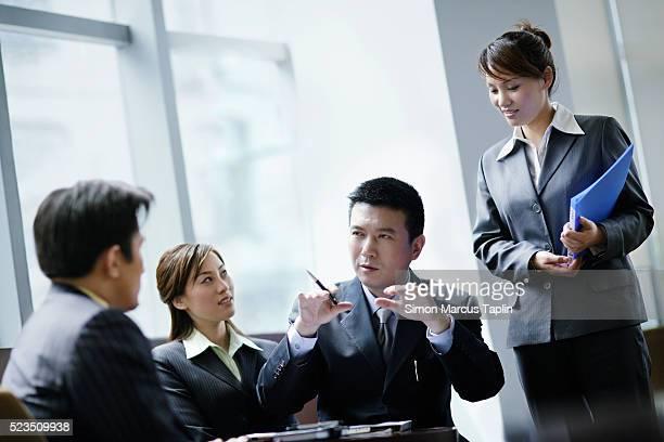Businessman Explaining to Others