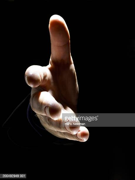 Businessman extending hand for handshake, close-up
