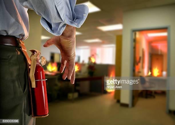 businessman extinguishing office fire - 消火器 ストックフォトと画像