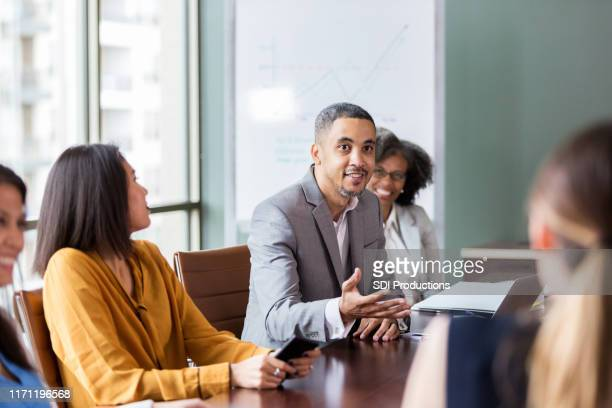 businessman facilitates meeting - american influenced stock photos and pictures