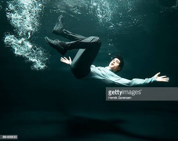 businessman falling in water