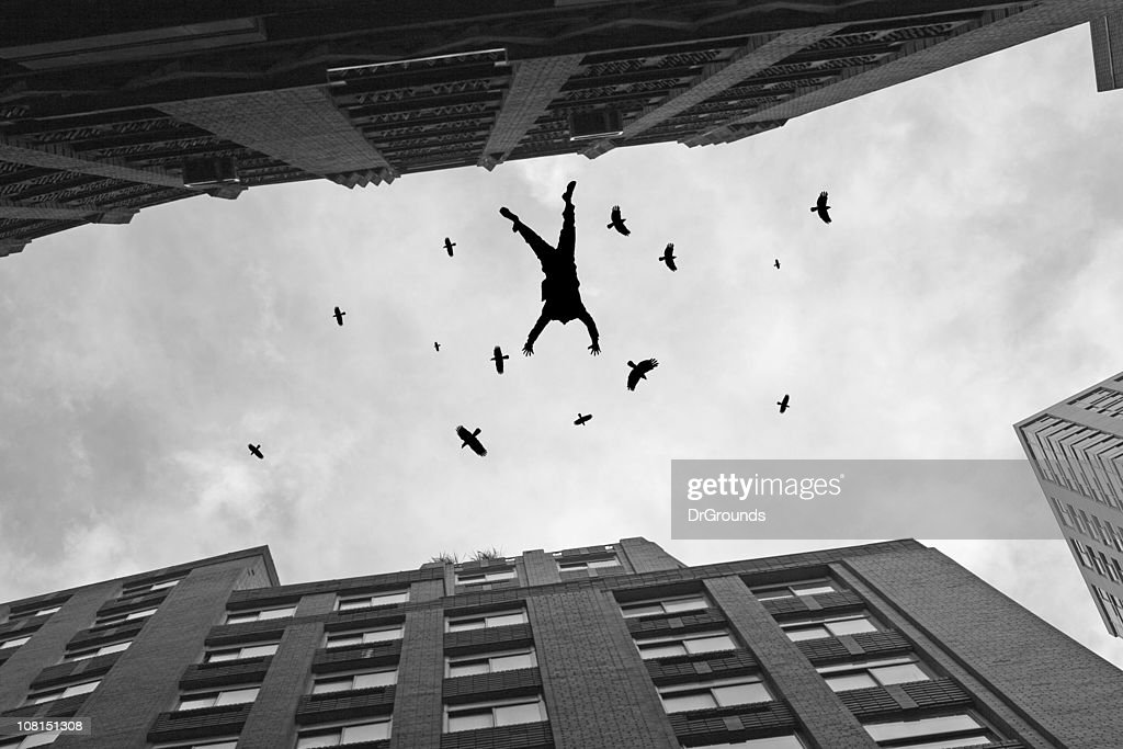 Businessman Falling Off Office Building Roof with Birds Flying : Stockfoto