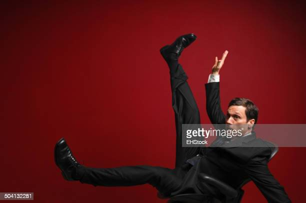 Businessman Falling on Red