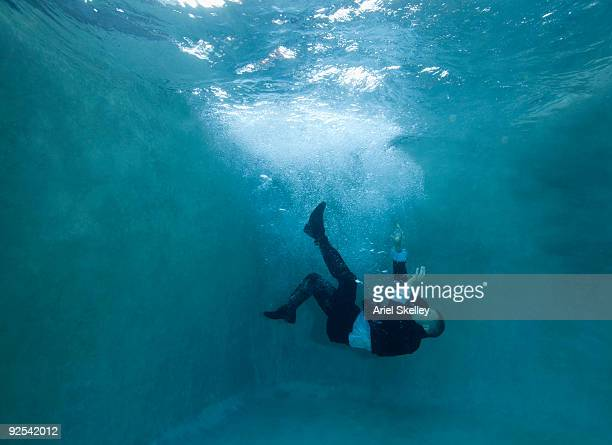 Businessman Falling Under Water
