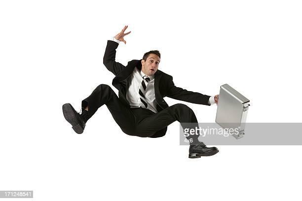 ビジネスマン落ちるブリーフケース付き