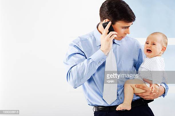 businessman father holding crying baby - shirt and tie stock pictures, royalty-free photos & images