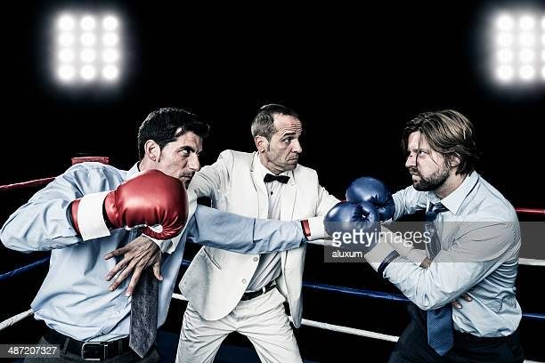 businessman fight - referee stock photos and pictures
