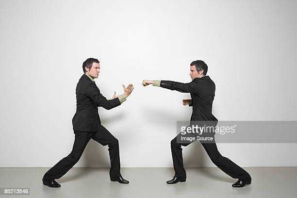 Businessman fighting himself