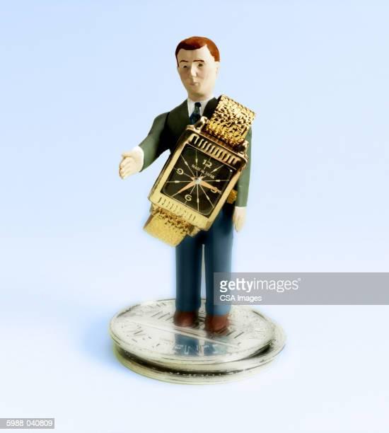 Businessman Figurine and Watch
