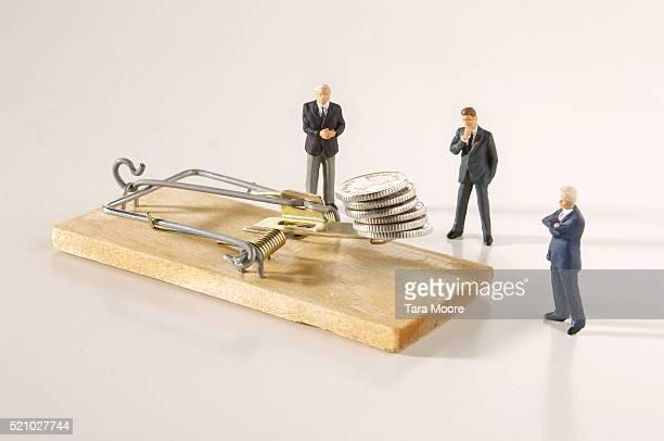 Businessman Figurines Pondering Mousetrap