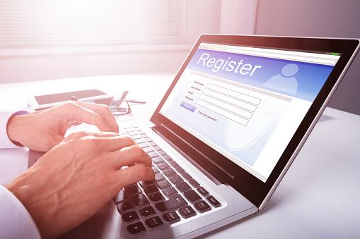 Businessman Filling Online Registration Form 1013435204
