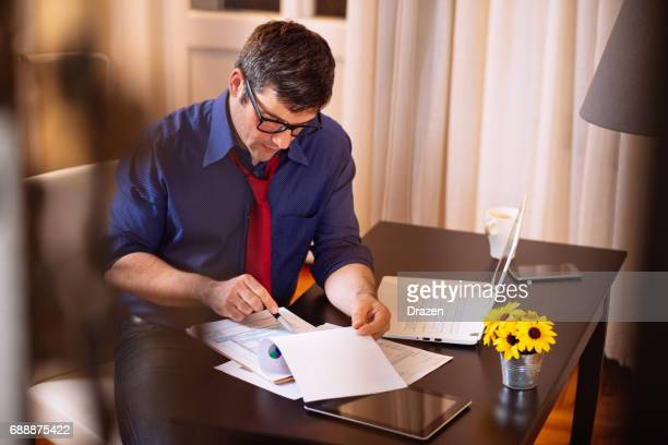 Businessman filling out 1040 tax form