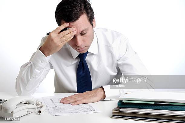 Businessman Filling out Tax Forms