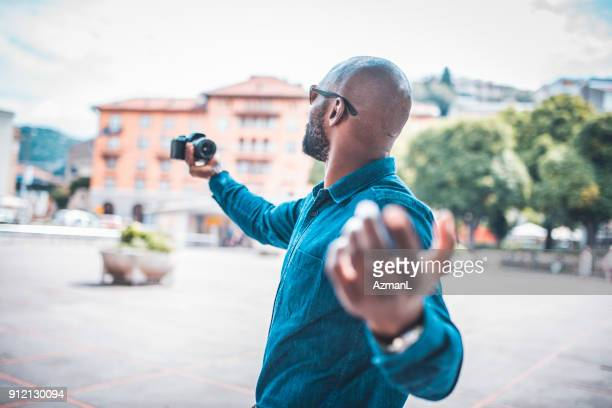 businessman filming a vlog - influencer stock photos and pictures