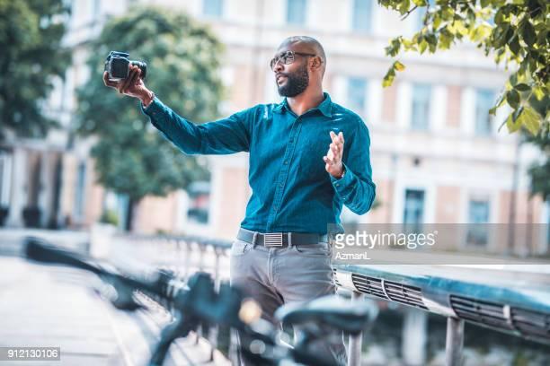 Businessman filming a vlog