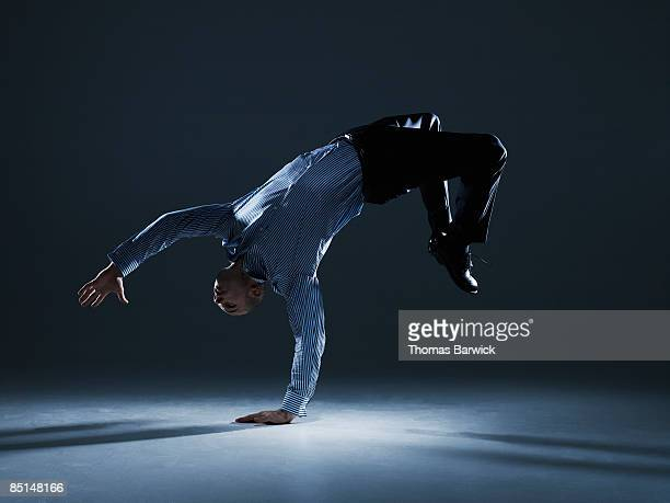 businessman flipping over backwards - flexibility stock pictures, royalty-free photos & images
