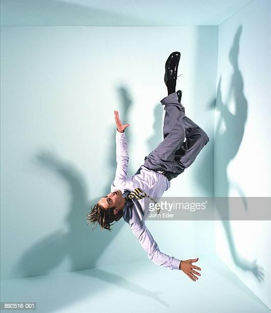 businessman floating in mid-air - auf den kopf gestellt stock-fotos und bilder