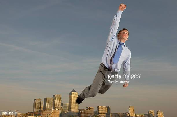 Businessman flying over the city