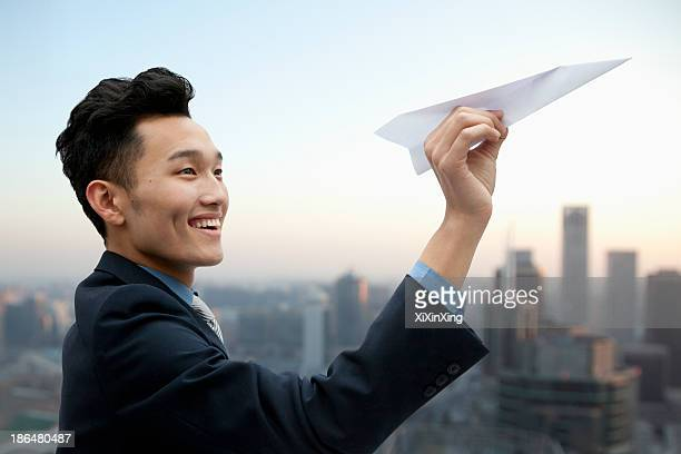 Businessman Flying Paper Airplane
