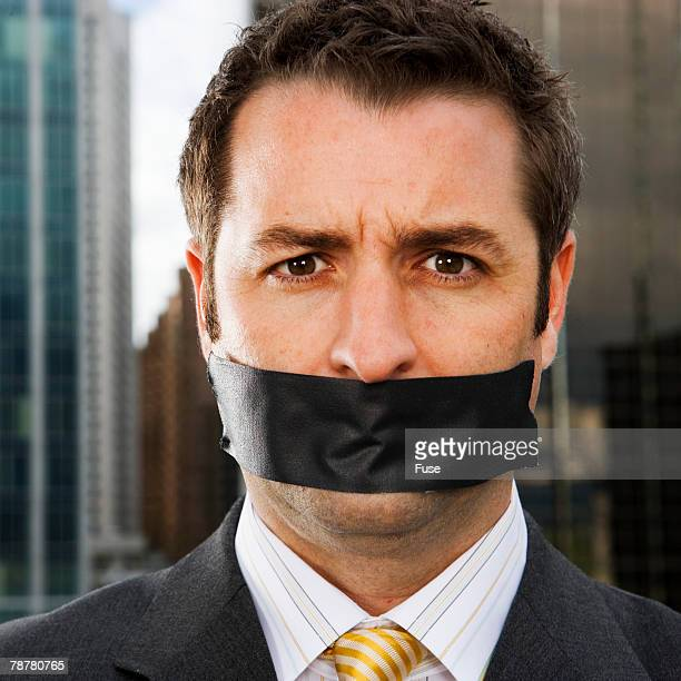 businessman gagged with black tape - gagged black stock pictures, royalty-free photos & images