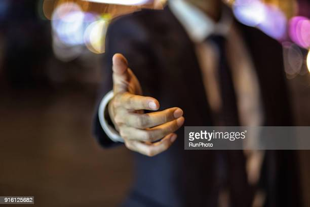 businessman gesturing invitation, close-up - invitation stock pictures, royalty-free photos & images