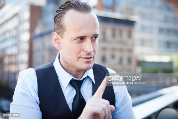 businessman gesturing with finger - schütteln stock-fotos und bilder