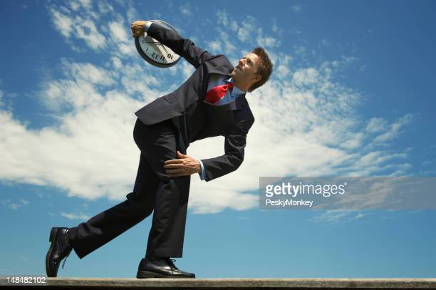 Businessman Gets Ready to Throw Discus Clock