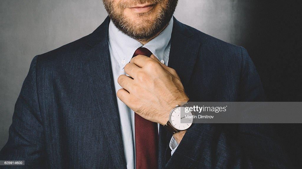 Businessman getting dressed : Stock Photo