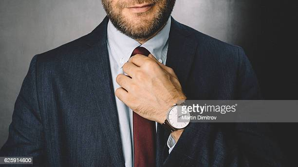 businessman getting dressed - tie stock pictures, royalty-free photos & images
