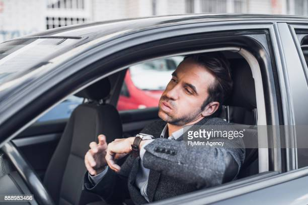 businessman getting impatient in the car - impatience flowers stock pictures, royalty-free photos & images