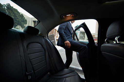 Businessman getting into backseat of exclusive cab - gettyimageskorea