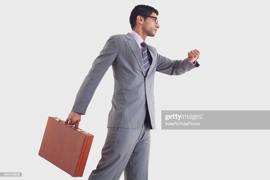 Businessman getting late for work : Stock Photo