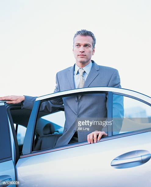 businessman getting out of a car - 降り立つ ストックフォトと画像