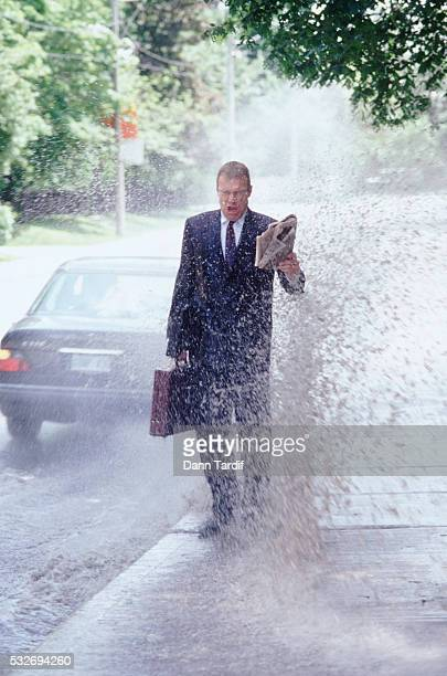 Businessman getting splashed