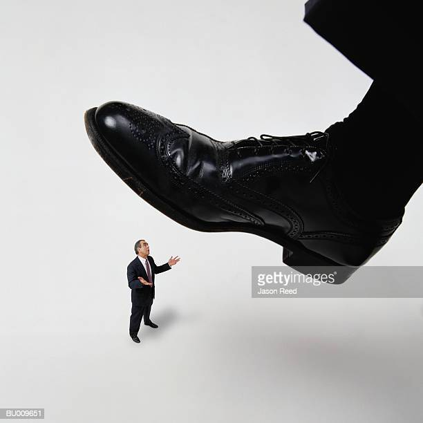 Businessman Getting Stepped On