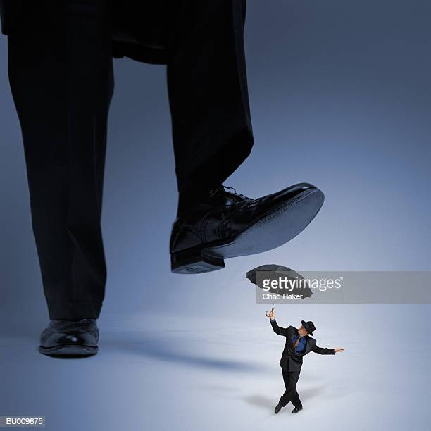 businessman getting stepped on - stepping stock pictures, royalty-free photos & images