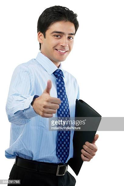 businessman giving a thumbs-up - new generation stock pictures, royalty-free photos & images