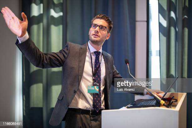 businessman giving presentation at convention center - identity card stock pictures, royalty-free photos & images