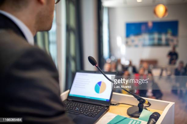 businessman giving presentation at convention center - entertainment event stock pictures, royalty-free photos & images