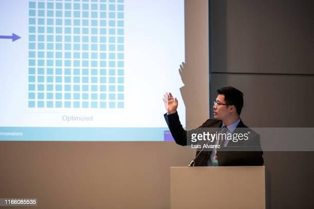 businessman giving presentation during a seminar - 演壇 ストックフォトと画像