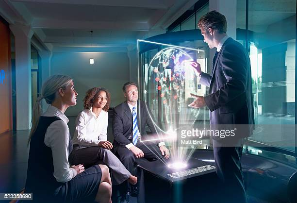 businessman giving presentation on futuristic device - hologram stock pictures, royalty-free photos & images
