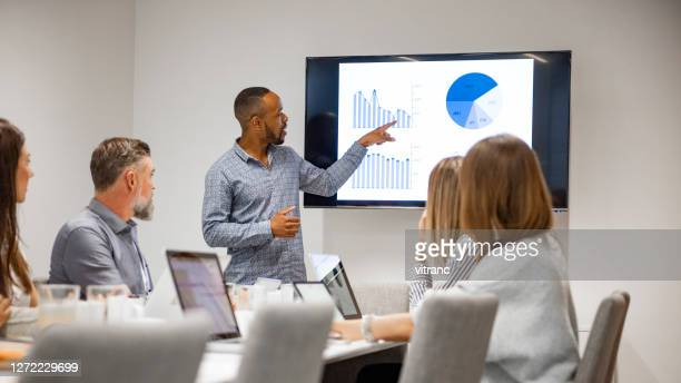 businessman giving presentation with colleagues - data stock pictures, royalty-free photos & images