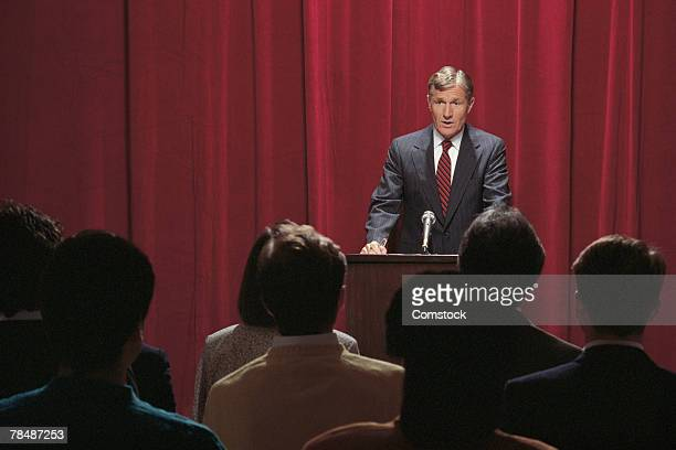 Businessman giving speech at podium