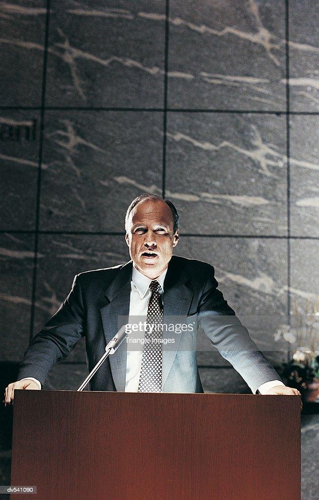 Businessman giving speech : Stock Photo