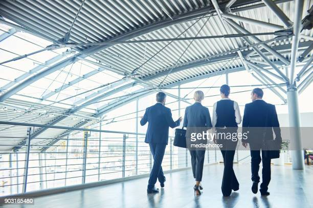 businessman giving tour to business partner over office - delegating stock photos and pictures