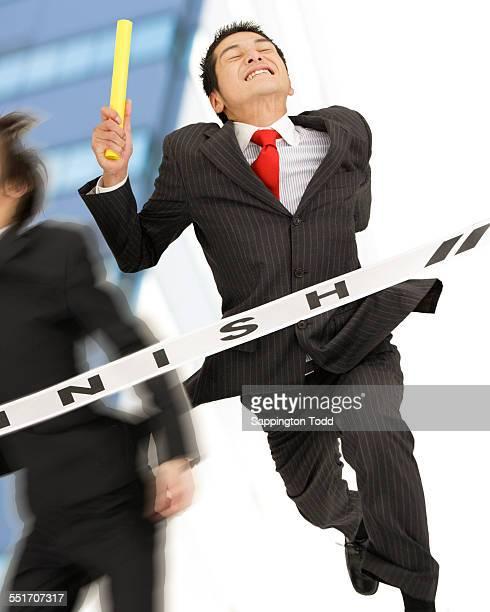Businessman Goal With A Baton