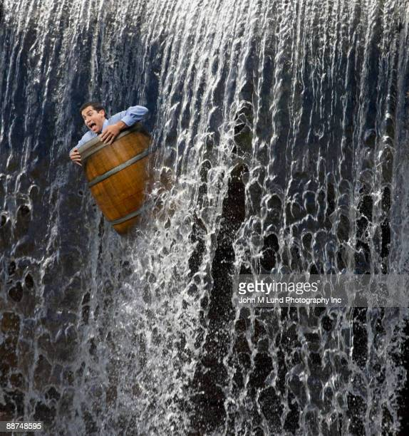 businessman going over waterfall in barrel - special:random stock pictures, royalty-free photos & images