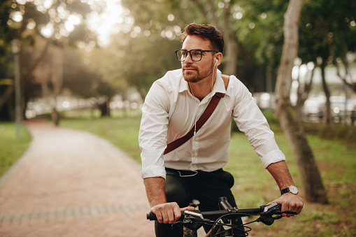 Businessman going to office on bicycle 1125707375
